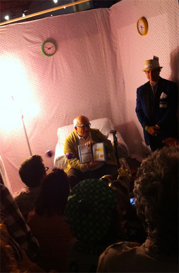 Now For an iPhotograph of Ed Asner Reading <em>Hop on Pop</em> at the Doll Factory