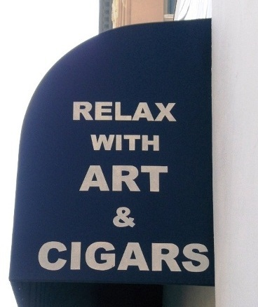 Sign Waves: Relax with Art & Cigars